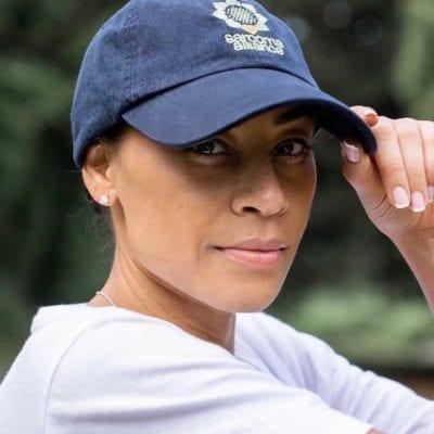 Brandi Benson wearing a Sarcoma Alliance baseball cap