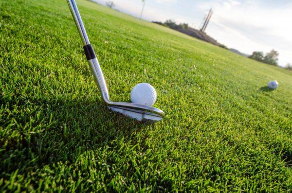 golf club at golf ball up close