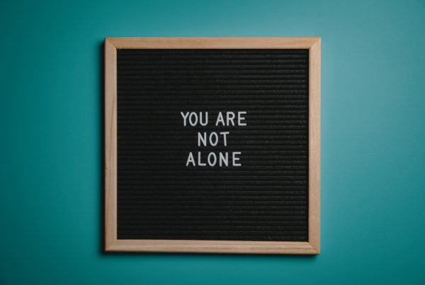"""Board that says """"You Are Not Alone"""""""