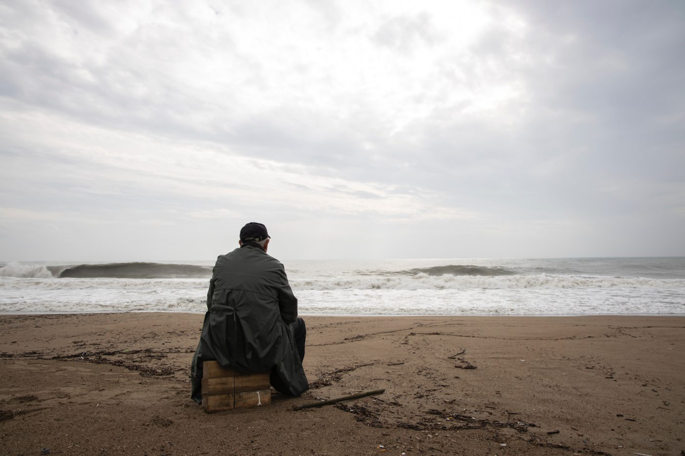 Elder on the beach alone